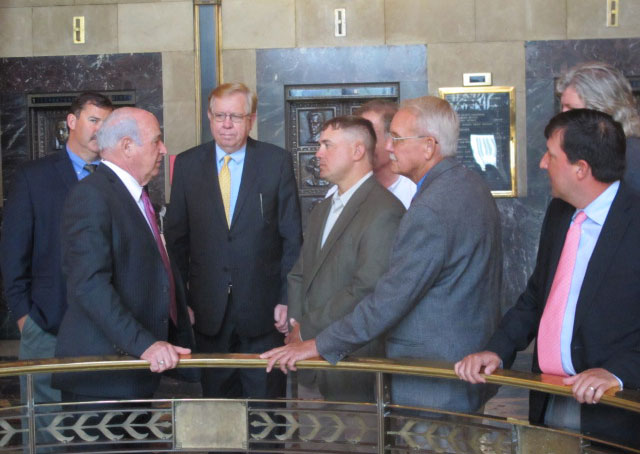 LA-Rice-Day,-Rep-Terry-Brown-& Farm Leaders stand in group near bank of elevators