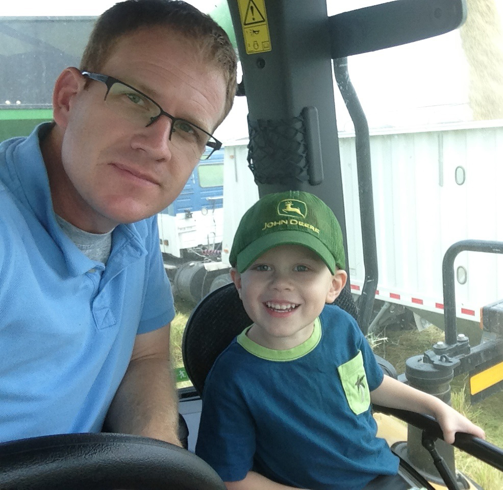 Mark Isbell and son, Sam, in a combine