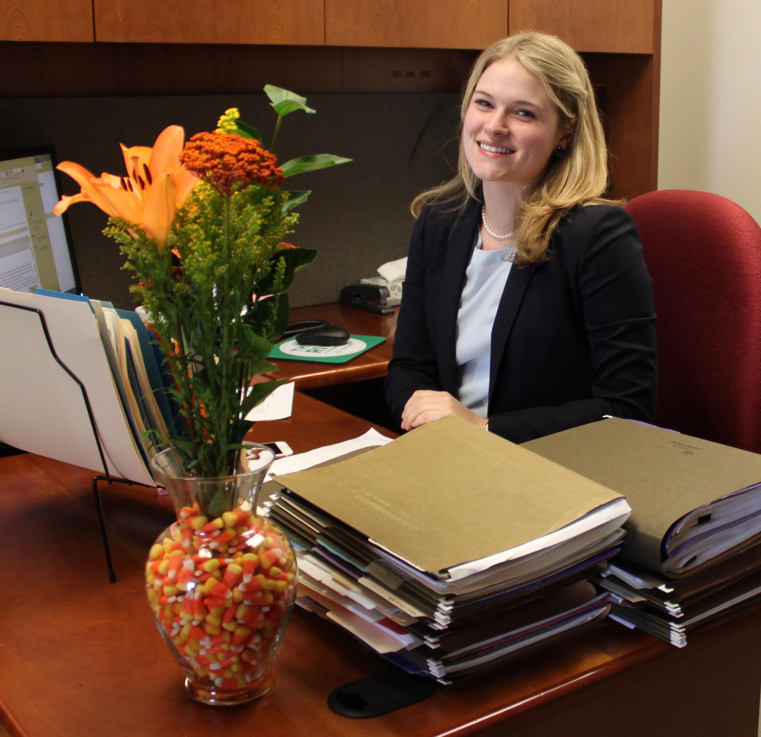 Lydia-Holmes-at her desk at USA Rice